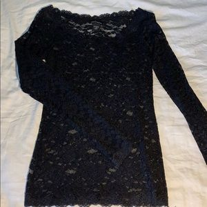 Lace, fitted, black top.